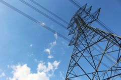 High voltage tower or Electric transmission line with blue sky and white cloud Royalty Free Stock Photos