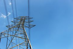 High voltage tower or Electric transmission line with blue sky and white cloud Royalty Free Stock Images