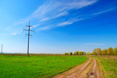 High voltage tower in field Stock Image