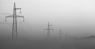 High-voltage tower in the fog Stock Photo