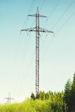 High-voltage Tower. In forest, blue sky background Stock Photography
