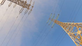 High-voltage tower with high voltage wires. On a background of blue sky stock video