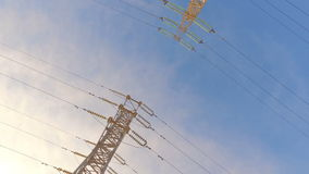 High-voltage tower with high voltage wires stock footage