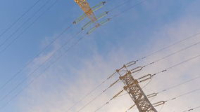 High-voltage tower with high voltage wires. On a background of blue sky stock footage