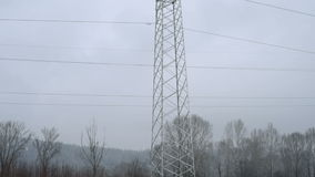 High-voltage tower with high voltage wires. In Siberia in winter stock video