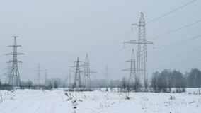 High-voltage tower with high voltage wires. In Siberia in winter stock footage