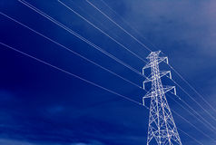 High Voltage Tower Landscape. High Voltage Power Line on Blue Sky royalty free stock image