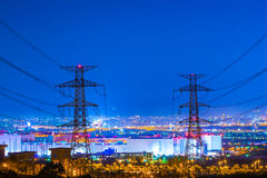 High voltage tower. Large high-voltage electricity tower offers the entire city Royalty Free Stock Photos