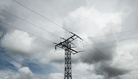 High-voltage tower in the middle stock images