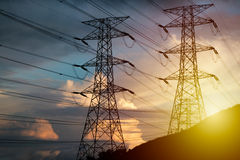 Free High Voltage Tower On Hillside During Sunset Royalty Free Stock Photography - 89896597