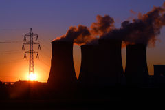 High voltage tower and power plant chimney Stock Image