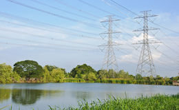 High voltage tower side of the pond Royalty Free Stock Photos