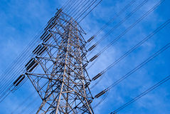High voltage tower into sky. High voltage tower are big power transport Royalty Free Stock Photography