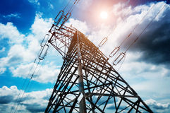 High-voltage tower sky background Stock Photo