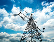 High-voltage tower sky background Stock Images
