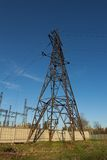 High-voltage tower sky background. Royalty Free Stock Photo