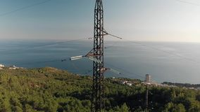 High-voltage tower sky. Against sea stock video