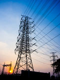 High-voltage tower with sun set Stock Images
