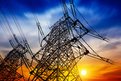 High voltage tower. At sunset Stock Photos