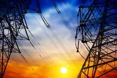 High voltage tower. At sunset Royalty Free Stock Photo