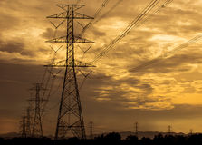 High voltage tower with sunset background Royalty Free Stock Images