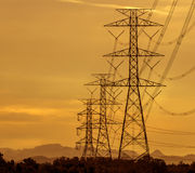 High voltage tower with sunset background Royalty Free Stock Image