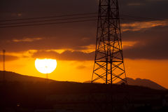 High voltage tower and sunset Stock Photos