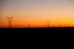 High voltage tower. Sunset with several high voltage tower Stock Photo