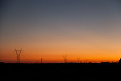 High voltage tower. Sunset with several high voltage tower Royalty Free Stock Images