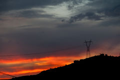 High voltage tower. Sunset with several high voltage tower Royalty Free Stock Photo