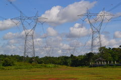 High Voltage Tower. S across the land for plantations Royalty Free Stock Image