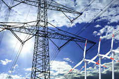High voltage tower and wind turbine  line in the sky Stock Photo