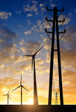High voltage tower and wind turbines Stock Photo