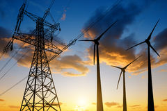 High voltage tower and wind turbines Stock Images