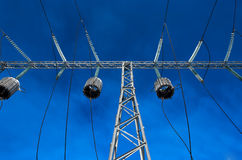 High-voltage tower wire. High-voltage wires against a blue sky Stock Photo