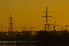 High-voltage tower and wires on sunset background. The high-voltage tower and wires on sunset background Stock Photography