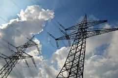 High voltage towers. On the background of the beautiful sky Stock Image