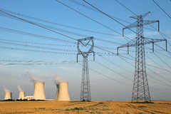 High voltage towers and nuclear power plant Royalty Free Stock Photography
