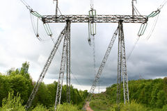 High voltage towers over storm-cloud Stock Images