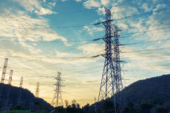 High voltage towers on skies background, Transmission line tower.  royalty free stock photography
