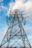 High voltage towers on skies background, Transmission line tower stock images