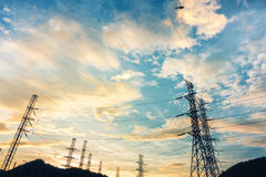 High voltage towers on skies background, Transmission line tower.  royalty free stock images