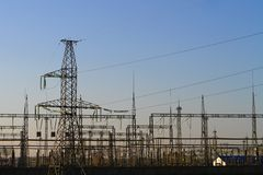 High voltage towers with sky background - industrial image stock photos