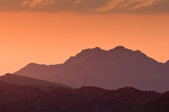 High voltage towers at sunset Stock Photography