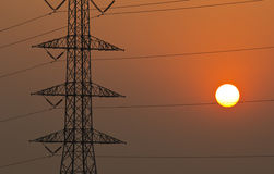 High voltage towers in sunset. Royalty Free Stock Photo