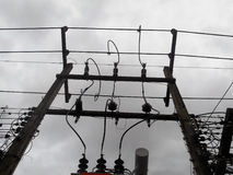 High Voltage Transformers are at home, power poles. Royalty Free Stock Photo