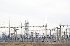 high-voltage transformers and power lines support. Electrical industry. Power station. Stock Image