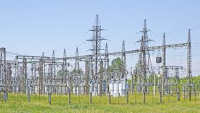 High-voltage transformers and power lines support. Electrical industry. Power station. Stock Photo
