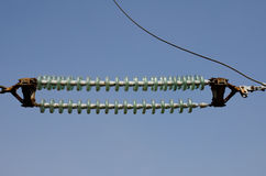 High-voltage Transmission Insulators against the blue sky Stock Images