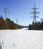 high-voltage transmission line with electricity pylons Stock Photo